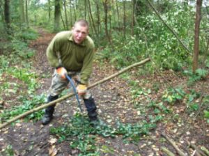 Volunteer helping with woodland management