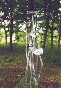 A silver mushroom statue